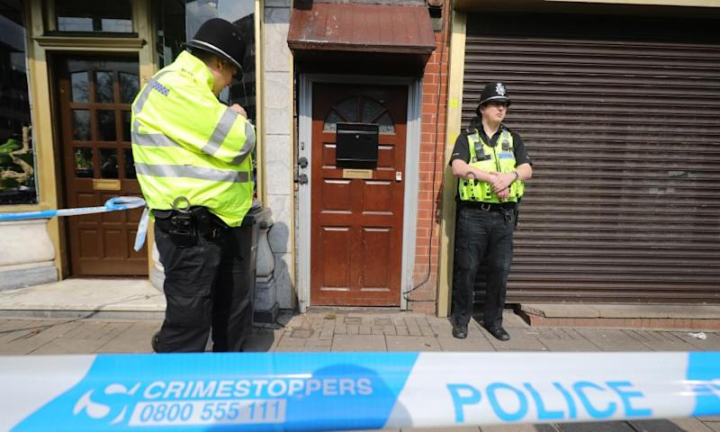 Police guard a Birmingham flat which was raided in connection with the Westminster attack