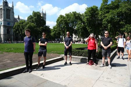 Members of the public observe a minute's silence following the recent Manchester Arena bombing, in Parliament Square in London, Britain, May 25, 2017. REUTERS/Neil Hall