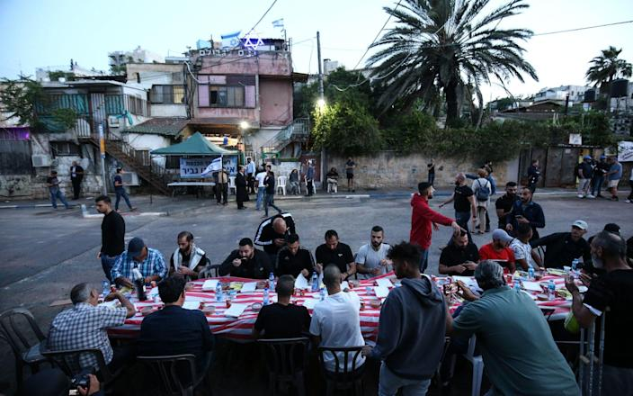 Palestinians, whom Israel want to forcibly evict from their homes, and their supporters set a dinner table for the breaking of the Ramadan fast in front of their homes at Sheikh Jarrah