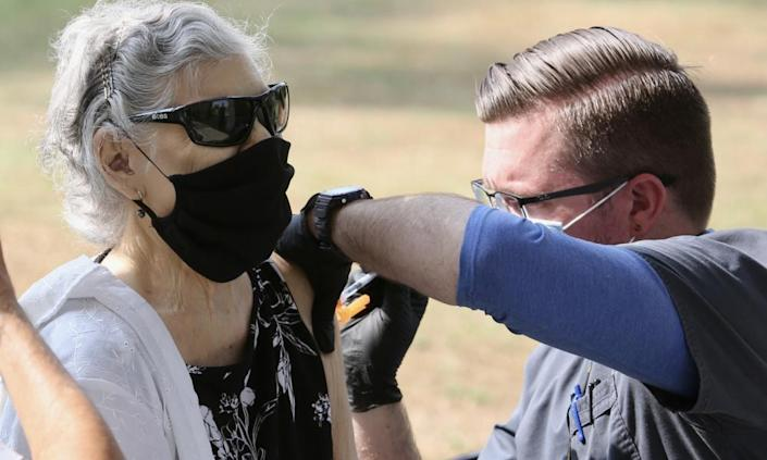 A woman receives a Covid-19 booster shot in Pasadena, Los Angeles county, California, this week.