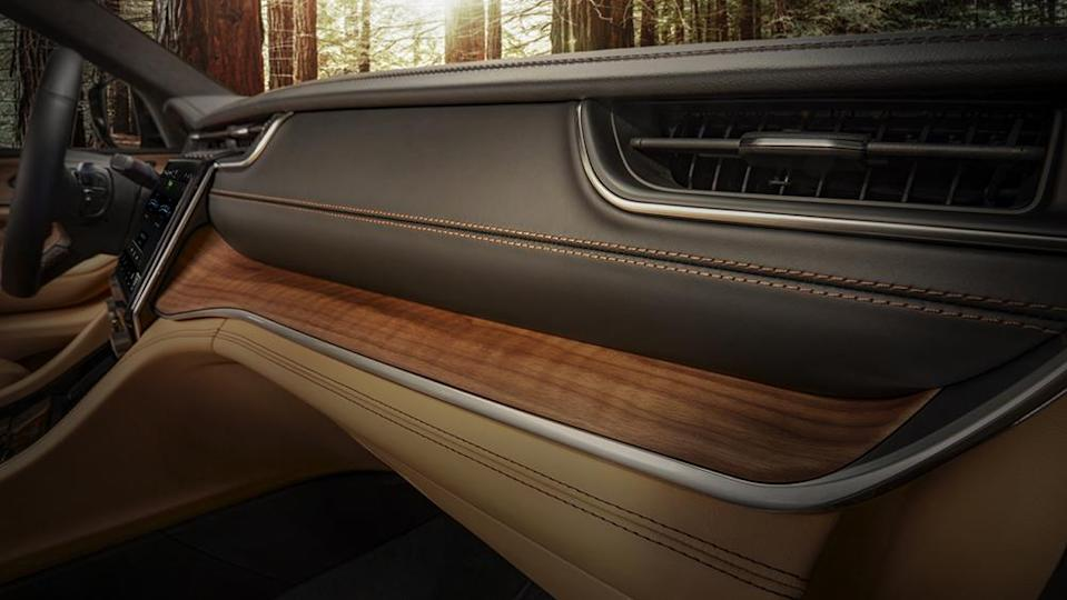 2021 Jeep® Grand Cherokee L Summit Reserve leather-wrapped instrument panel with open-pore Waxed Walnut accents and all-new slim HVAC vents