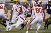 Utah quarterback Jake Bentley (8) keeps the ball against Washington during the first half of an NCAA college football game Saturday, Nov. 28, 2020, in Seattle. (AP Photo/Ted S. Warren)
