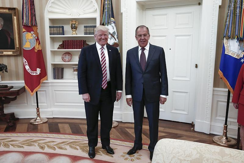 US President Donald J. Trump (left) poses with Russian Foreign Minister Sergei Lavrov during a meeting at the White House in Washington, DC on May 10, 2017