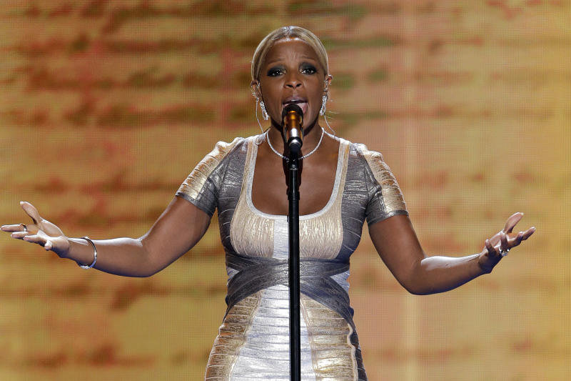 FILE - In this Thursday, Sept. 6, 2012 file photo, Mary J. Blige preforms during the Democratic National Convention in Charlotte, N.C. Blige and her husband have been hit with a $3.4 milion tax lien by the IRS. Court documents in New Jersey show the Internal Revenue Service filed a notice of a lien on the nine-time Grammy winner on Feb. 7, 2013. Blige and her husband, Martin Isaacs, have a home in Cresskill, N.J., about 15 miles north of New York City. (AP Photo/J. Scott Applewhite)