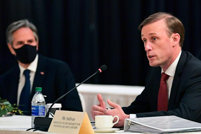 Secretary of State Antony Blinken, left, listens as White House national security adviser Jake Sullivan, right, speaks at the opening session of U.S.-China talks at the Captain Cook Hotel in Anchorage, Alaska, on March 18.