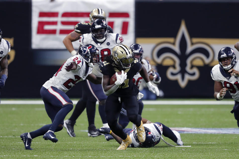 New Orleans Saints running back Alvin Kamara (41) carries against Houston Texans cornerback Johnathan Joseph (24) in the second half of an NFL football game in New Orleans, Monday, Sept. 9, 2019. (AP Photo/Bill Feig)