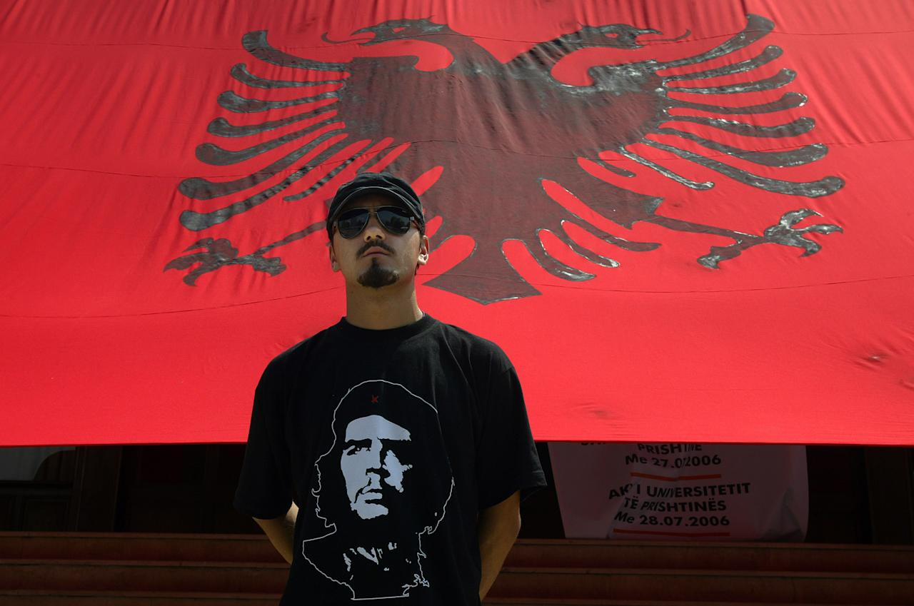 "** FILE ** An ethnic Albanian supporter of a group called ""SELF DETERMINATION"" wearing a T-shirt with Che Guevara portrait in front of an Albanian flag protests in capital Pristina, Kosovo in this file photo taken on Monday, July 24, 2006. It started off as a ragtag group of youngsters, but now Self-Determination, the group behind the latest violence in Kosovo, is raising the stakes in the province's quest for full independence from Serbia. (AP Photo/Visar Kryeziu)"