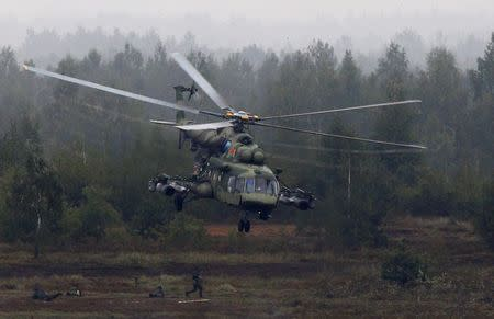 A Mi-8 helicopter flies above servicemen during the Zapad 2017 war games at a range near the town of Borisov, Belarus September 20, 2017. REUTERS/Vasily Fedosenko