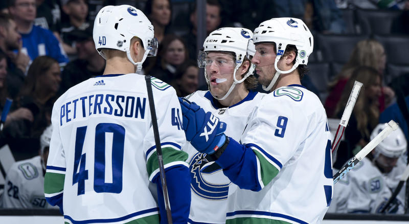 LOS ANGELES, CA - OCTOBER 30: Elias Pettersson #40, Brock Boeser #6, and J.T. Miller #9 of the Vancouver Canucks talk while waiting for play to resume during the second period of the game against the Los Angeles Kings at Staples Center on October 30, 2019 in Los Angeles, California. (Photo by Juan Ocampo/NHLI via Getty Images)