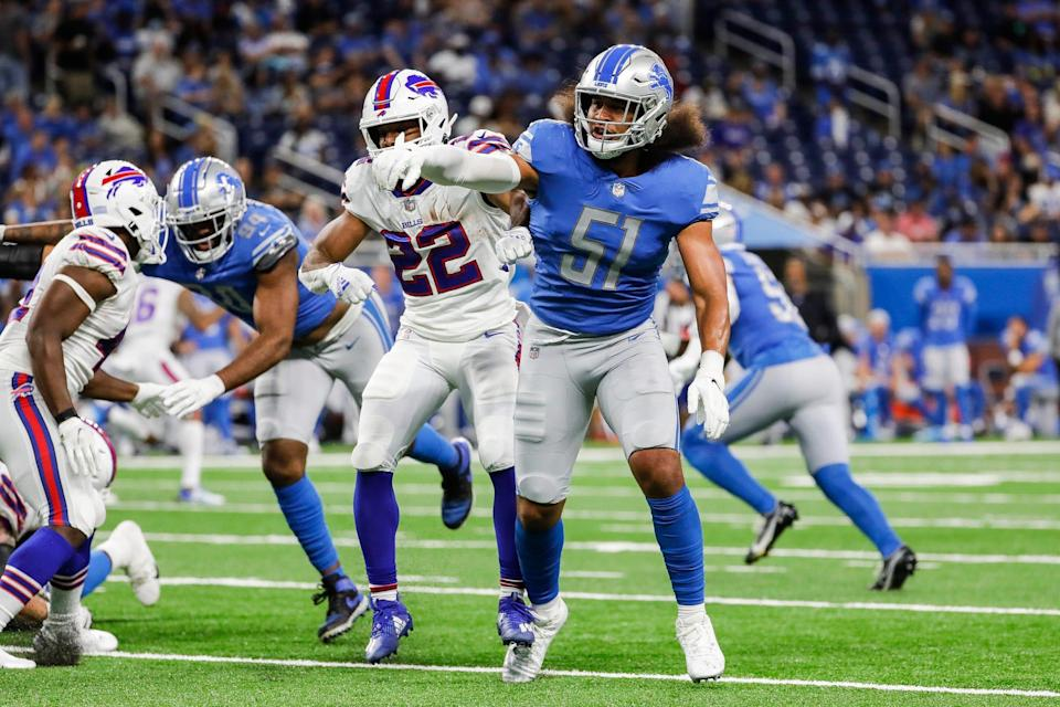 Detroit Lions linebacker Jahlani Tavai (51) tries to stop Buffalo Bills running back Matt Breida (22) during the first half of the preseason game  at Ford Field in Detroit on Friday, Aug. 13, 2021.