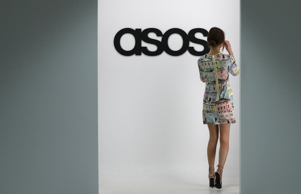 A model walks on an in-house catwalk at the ASOS headquarters in London April 1, 2014. British online fashion retailer ASOS posted a 22 percent fall in first half profit, reflecting its move to step-up the pace of infrastructure investment to meet future demand. The firm said on Wednesday it made a pretax profit of 20.1 million pounds ($33.4 million) in the six months to Feb. 28, down from 25.7 million pounds in the same period last year. Picture taken April 1, 2014.   REUTERS/Suzanne Plunkett (BRITAIN - Tags: BUSINESS FASHION)