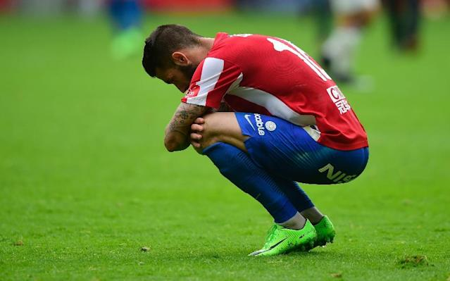 Sporting Gijon's Lillo Castellano crouches at the end of their match against Real Madrid at El Molinon stadium in Gijon on April 15, 2017 (AFP Photo/MIGUEL RIOPA)
