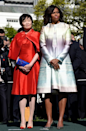 <p>To welcome Japanese prime minister Shinzo Abe and his wife Akie Abe to the United States, the mother of two wore a Monique Lhullier dress with matching jacket that featured the pastel colors of a setting sun on the print. She finished the colorful look with silver shiny heels. </p>