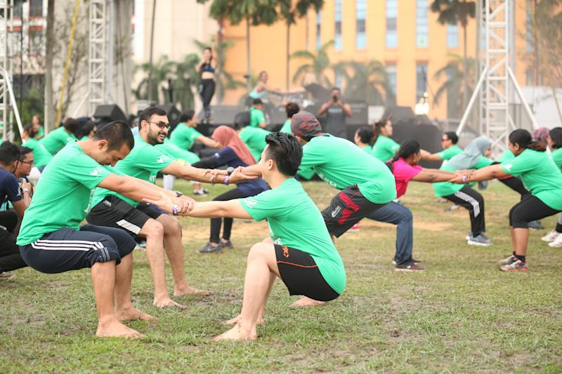 Relayers take part in a warm up activity during the event. — Picture courtesy of the National Cancer Society of Malaysia