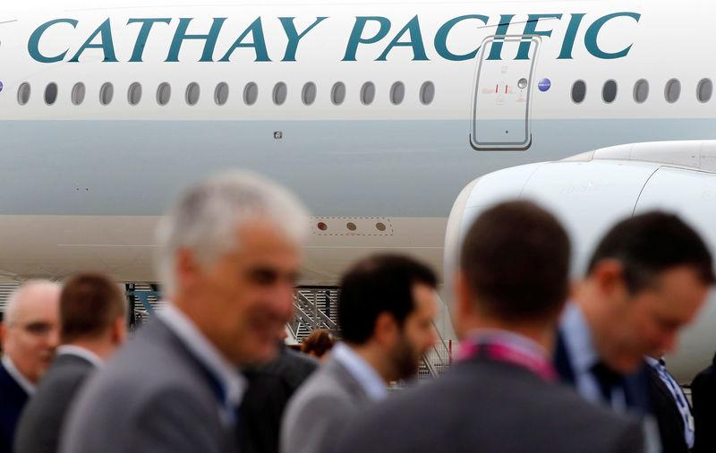 FILE PHOTO: A passenger plane of Cathay Pacific Airways parks at the airport in Colomiers near Toulouse, France