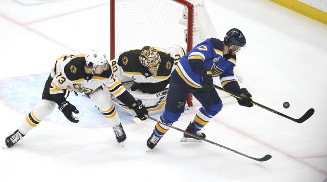 Boston Bruins goaltender Tuukka Rask (40), of Finland, and defenseman Charlie McAvoy (73) follow St. Louis Blues left wing Jaden Schwartz (17) during the first period of Game 6 of the NHL hockey Stanley Cup Final Sunday, June 9, 2019, in St. Louis. (AP Photo/Scott Kane)