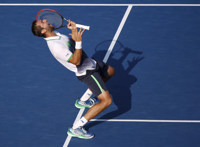 Marin Cilic, of Croatia, reacts after defeating Tomas Berdych, of the Czech Republic, during the quarterfinals of the 2014 U.S. Open tennis tournament, Thursday, Sept. 4, 2014, in New York.(AP Photo/Seth Wenig)