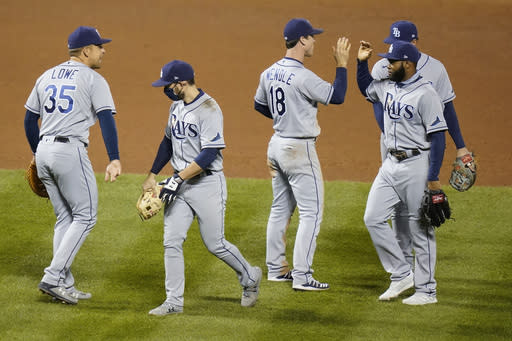 Tampa Bay Rays' Nate Lowe (35) and Joey Wendle (18) celebrate with teammates after a baseball game against the New York Mets Monday, Sept. 21, 2020, in New York. The Rays won 2-1. (AP Photo/Frank Franklin II)