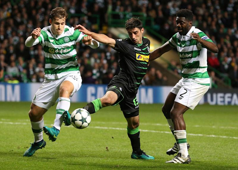 FILE - This is a Wednesday Oct. 19, 2016 file photo of Moenchengladbach's Lars Stindl, center, as he is challenged by Celtic's players Erik Sviatchenko, left, and Kolo Toure during the Champions League group C soccer match at Celtic Park, Glasgow, Scotland, Wednesday Oct. 19, 2016. Celtic in their Scottish Premier League matches are unbeaten in 29 games, winning 27 of them. They hold a 25-point lead. They're about to clinch a sixth straight league title this weekend and it's still not even April - Credit: Scott Heppell/AP
