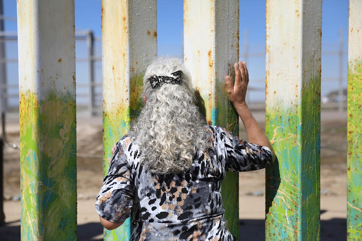 "Maria Rodriguez Torres, 70, looks towards her departing grandchildren after seeing them for the first time at the U.S.-Mexico border fence in Tijuana, Mexico. She had traveled with family members from Mexico City to see her grandchildren through the fence at ""Friendship Park."""