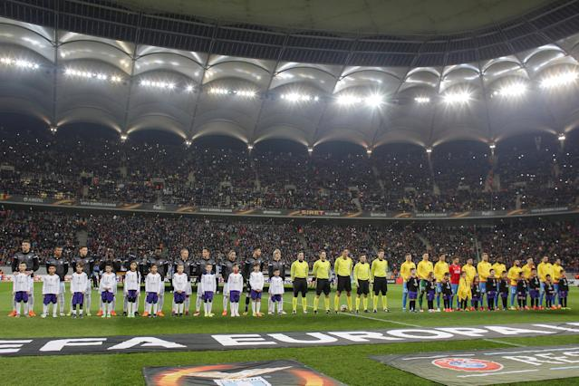 Soccer Football - Europa League Round of 32 First Leg - Steaua Bucharest vs Lazio - National Arena, Bucharest, Romania - February 15, 2018 General view of players and officials lined up before the match Inquam Photos/Octav Ganea via REUTERS ROMANIA OUT. NO COMMERCIAL OR EDITORIAL SALES IN ROMANIA THIS IMAGE HAS BEEN SUPPLIED BY A THIRD PARTY. IT IS DISTRIBUTED, EXACTLY AS RECEIVED BY REUTERS, AS A SERVICE TO CLIENTS