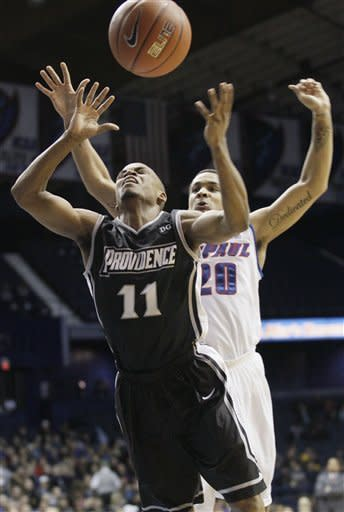 Providence guard Bryce Cotton (11) goes for a loose ball against DePaul guard Brandon Young (20) during the first half of an NCAA college basketball game in Rosemont, Ill., on Saturday, Feb. 25, 2012. (AP Photo/Nam Y. Huh)