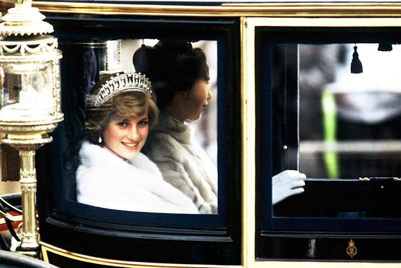 Now Princess of Wales, Diana accompanied Princess Anne in the glass coach used for her wedding to the state opening of Parliament, tiara in tow.