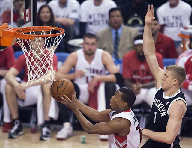 Toronto Raptors guard Kyle Lowry, left, drives to the net past Brooklyn Nets forward Mason Plumlee, right, during the first half of Game 5 of the opening-round NBA basketball playoff series in Toronto, Wednesday, April 30, 2014. (AP Photo/The Canadian Press, Nathan Denette)