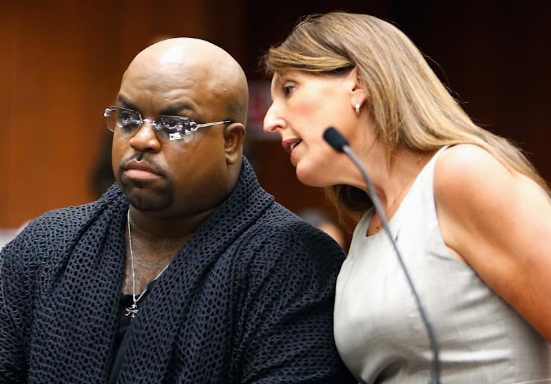 Singer Cee Lo Green, whose real name is Thomas DeCarlo Callaway, left, listens to attorney Blair Berk, during his arraignment at the Clara Shortridge Foltz Criminal Justice Center in downtown Los Angeles on Monday, Oct. 21, 2013. Green pleaded not guilty to giving a woman ecstasy at a Los Angeles restaurant during a 2012 dinner, and prosecutors declined to file a rape count against the singer because of insufficient evidence. The singer's bail was set at $30,000 and he is due back in court on Nov. 20, 2013. (AP Photo/Los Angeles Times, Mel Melcon, Pool)