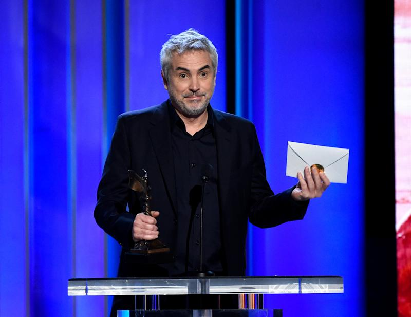 "Alfonso Cuaron accepts the award for best international film for ""Roma"" at the 34th Film Independent Spirit Awards on Saturday, Feb. 23, 2019, in Santa Monica, Calif. (Photo by Chris Pizzello/Invision/AP)"