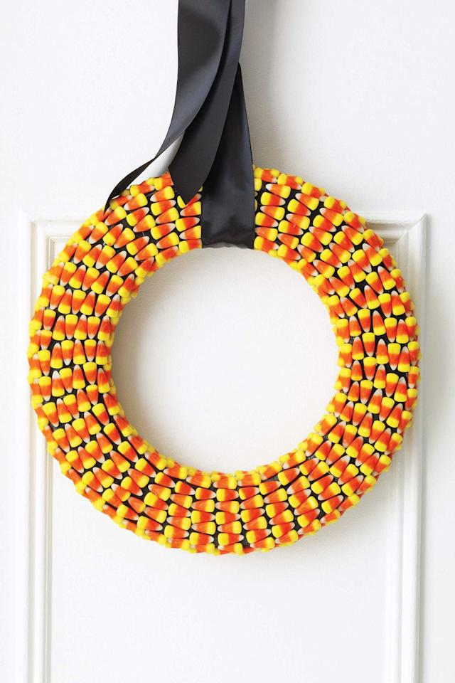 "<p>If you have <em>way too much</em> candy corn lying around, create this colorful wreath before the kids snack on them.</p><p><em><a href=""https://www.womansday.com/home/crafts-projects/how-to/a5283/halloween-craft-candy-corn-wreath-111103/"" target=""_blank"">Get the tutorial for Candy Corn Wreaths.</a></em></p><p><strong>What you'll need</strong>: <a href=""https://www.amazon.com/Oh-Gourmet-Halloween-Wholesale-Pricing/dp/B07HJGJVQQ/ref=sr_1_2_sspa?crid=2K5LSEI6LSTR8&keywords=candy+corn+bulk&qid=1563293290&s=gateway&sprefix=candy+corn+b%2Caps%2C119&sr=8-2-spons&psc=1"" target=""_blank"">Candy corn</a> ($15 for 4 LB bag, amazon.com)</p>"