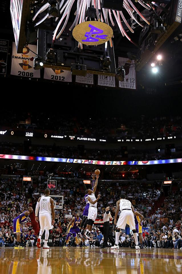 MIAMI, FL - FEBRUARY 10: Chris Bosh #1 of the Miami Heat and Dwight Howard #12 of the Los Angeles Lakers jump for the tipoff during a game  at American Airlines Arena on February 10, 2013 in Miami, Florida.  (Photo by Mike Ehrmann/Getty Images)
