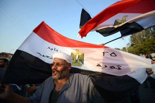 Egyptian supporters of the military council who do not support Egyptian President Mohamed Morsi, attend a rally in Cairo