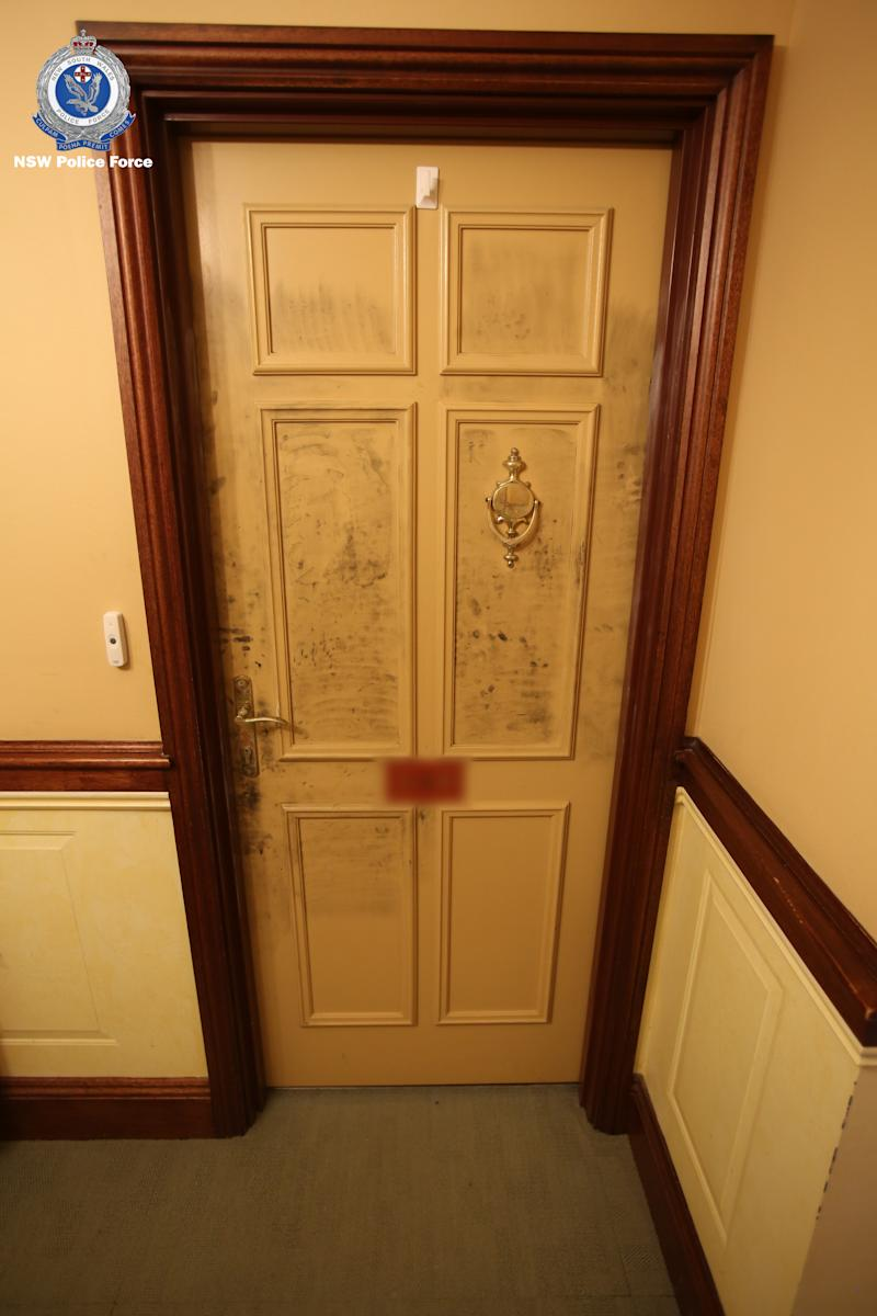 A photo of Patricia's scuffed door at her North Turramurra home was released by police.