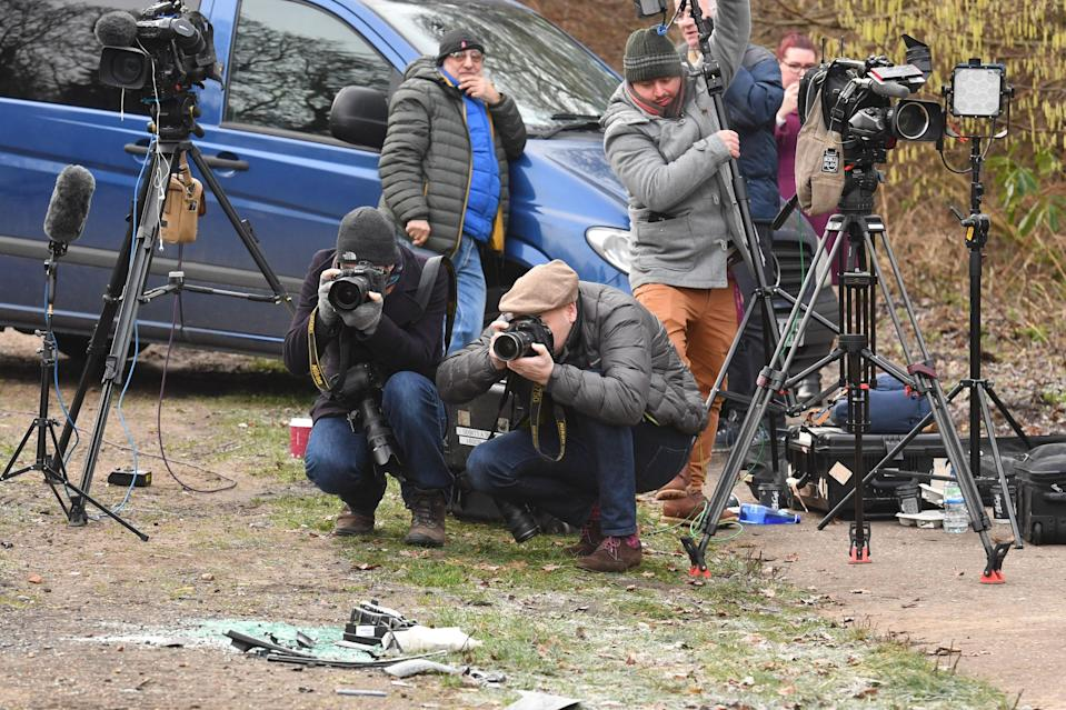 Media film broken glass and car parts on the side of the A149 near to the Sandringham Estate where the Duke of Edinburgh was involved in a road accident yesterday while driving [Photo: PA]