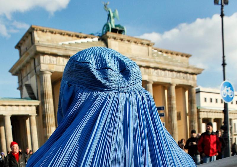 The burka has long been divisive in Germany. Here a woman demonstrates in front of the Brandenburg Gate in Berlin against the Bundeswehr army's deployment in Afghanistan in 2010