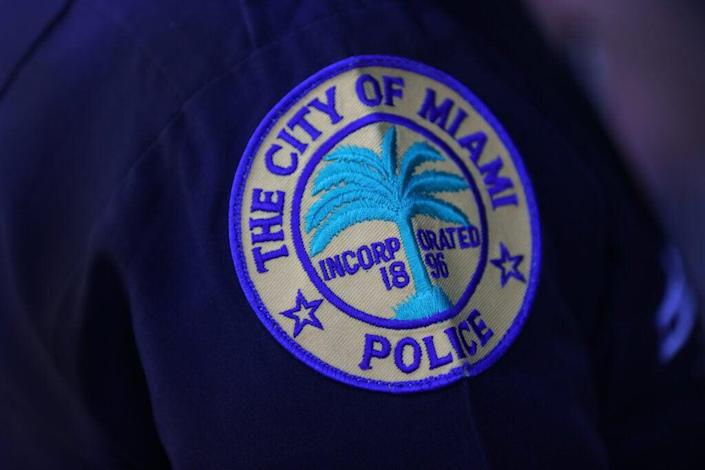A patch is seen on the shoulder of a police officer as the City of Miami's new Police Chief Art Acevedo speaks to the media during his introduction at City Hall on March 15, 2021 in Miami, Florida. Acevedo is leaving his job as police chief in Houston, Texas to take over Miami's police department of about 1,400 officers. (Photo by Joe Raedle/Getty Images)