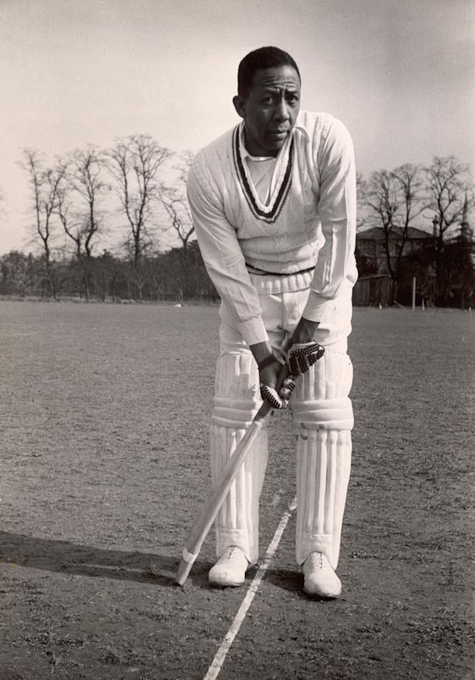 West Indian cricketer Learie Constantine (1901 - 1971) posing with his bat, late 1950's (Photo by Carl Sutton/Hulton Archive/Getty Images)
