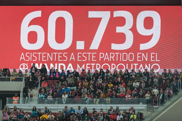The scoreboard displays the official attendance for Sunday's match in Madrid. (Getty)