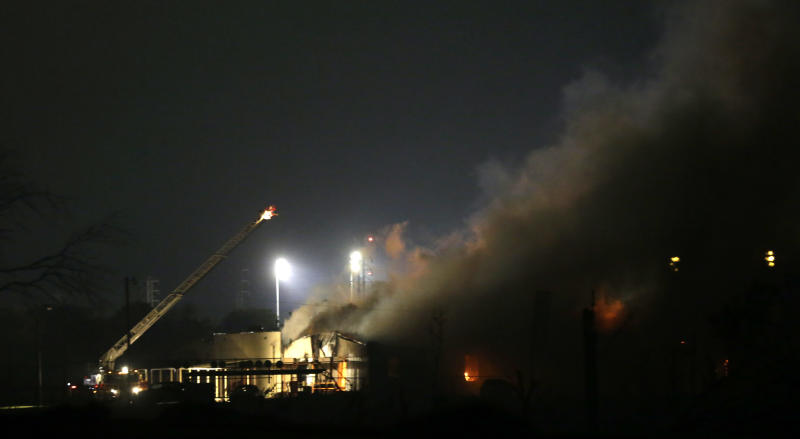 FILE - In this April 18, 2013 file photo, smoke rises near a fertilizer plant that exploded earlier in West, Texas, the night before. Four weeks after the explosion, investigators have yet to announce what prompted the fire and touched off the massive explosion that killed 14 people. (AP Photo/LM Otero, File)