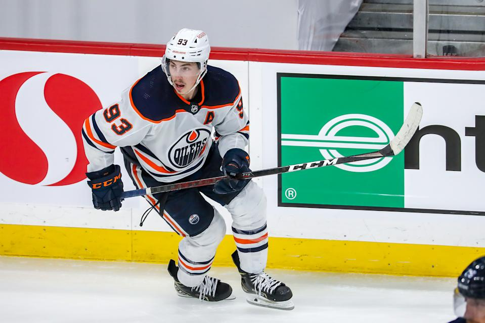 WINNIPEG, MB - MAY 24: Ryan Nugent-Hopkins #93 of the Edmonton Oilers keeps an eye on the play during action in the second overtime period against the Winnipeg Jets in Game Four of the First Round of the 2021 Stanley Cup Playoffs at Bell MTS Place on May 24, 2021 in Winnipeg, Manitoba. (Photo by Jonathan Kozub/NHLI via Getty Images)