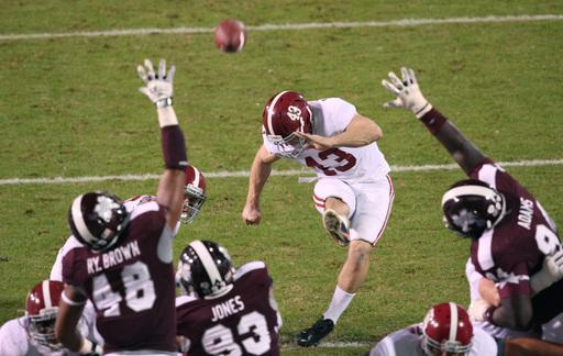 Alabama kicker Cade Foster (43) kicks a point past Mississippi State defenders during the second half of an NCAA college football game on Saturday, Nov. 16, 2013, in Starkville, Miss. (AP Photo/Kerry Smith)