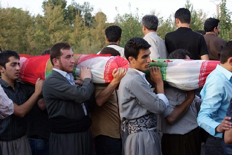 Iranian Kurds (pictured October 2010) carry the flag-drapped bodies of victims of a bomb atttack that tore through an Iranian military parade on September 22, 2010, killing 12 people in the ethnically Kurdish northwestern town of Mahabad (AFP Photo/Rahim Baizidi)