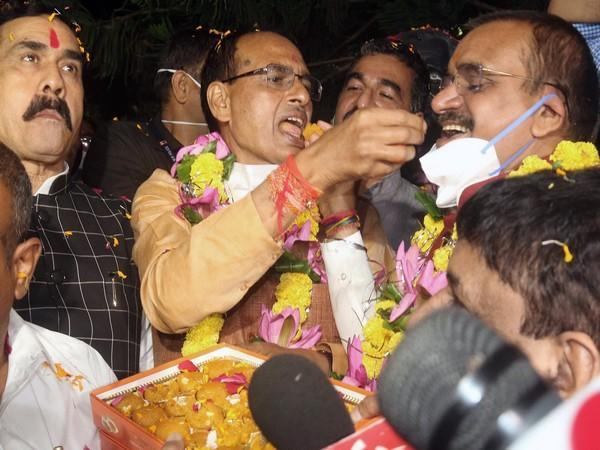 Chief Minister Shivraj Singh Chouhan and BJP State President VD Sharma with party workers celebrate party's victory in Bhopal.