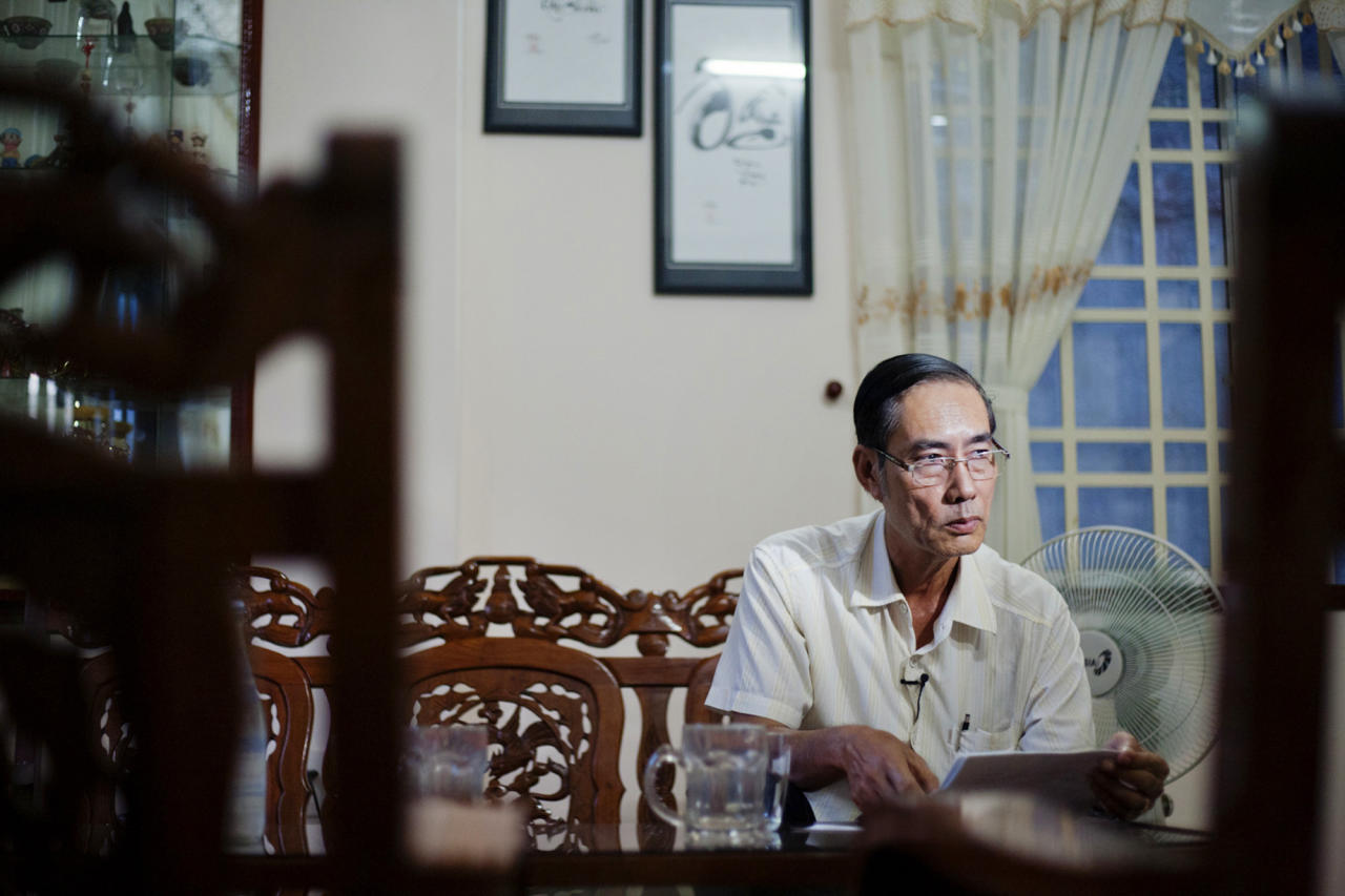 In this photo taken Aug. 7, 2012, Vo Duoc sits inside his home in Danang, Vietnam. He and 10 other members of the family were exposed to Agent Orange because of using of water in a lake near his home. Washington was slow to respond, but on Thursday, Aug. 9, 2012 the U.S. for the first time will begin cleaning up leftover dioxin that was stored at the former military base, now part of Danang's airport. (AP Photo/Maika Elan)