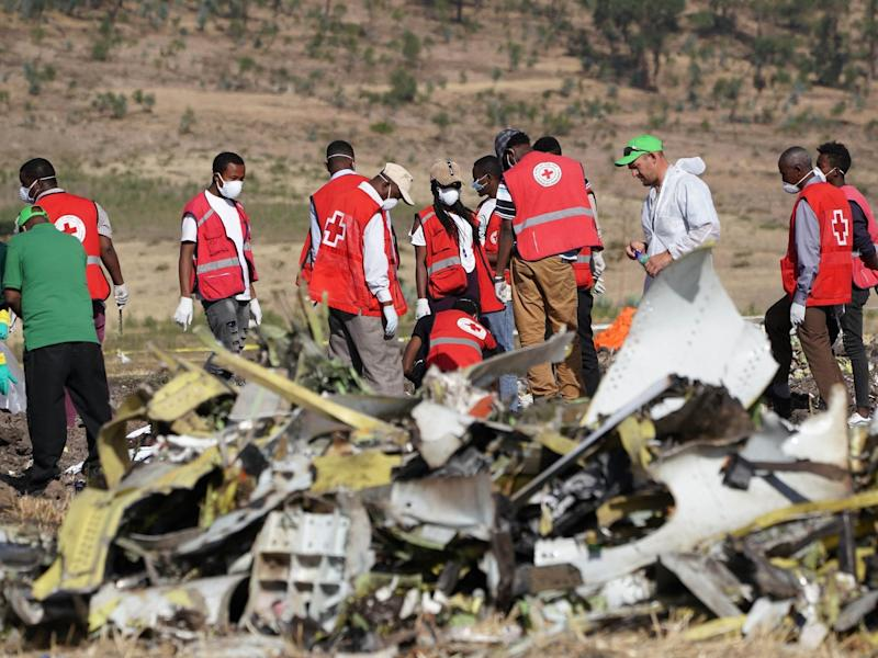 Forensics investigators and recovery teams at the crash site of Ethiopian Airlines Flight ET 302 on 12 March 2019 in Bishoftu, Ethiopia: Getty