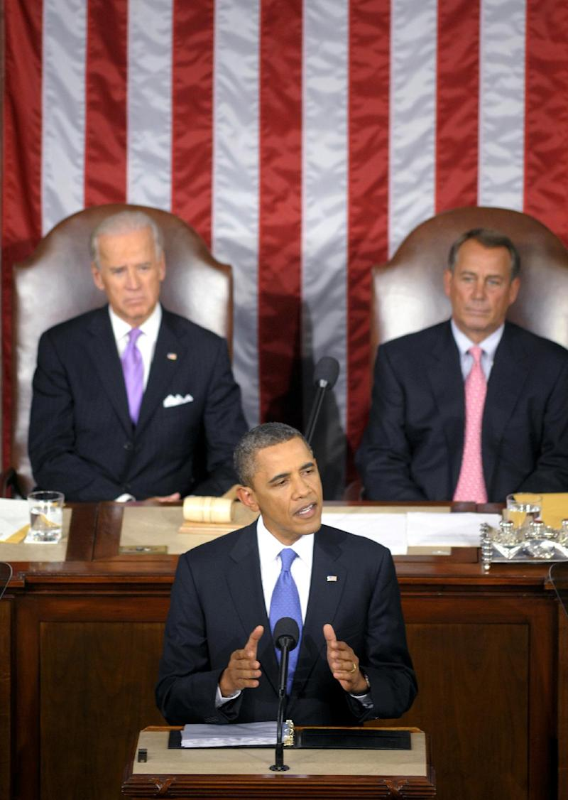 President Barack Obama delivers a speech to a joint session of Congress at the Capitol in Washington, Thursday, Sept. 8, 2011. Watching are Vice President Joe Biden and House Speaker John Boehner.  (AP Photo/Cliff Owen)