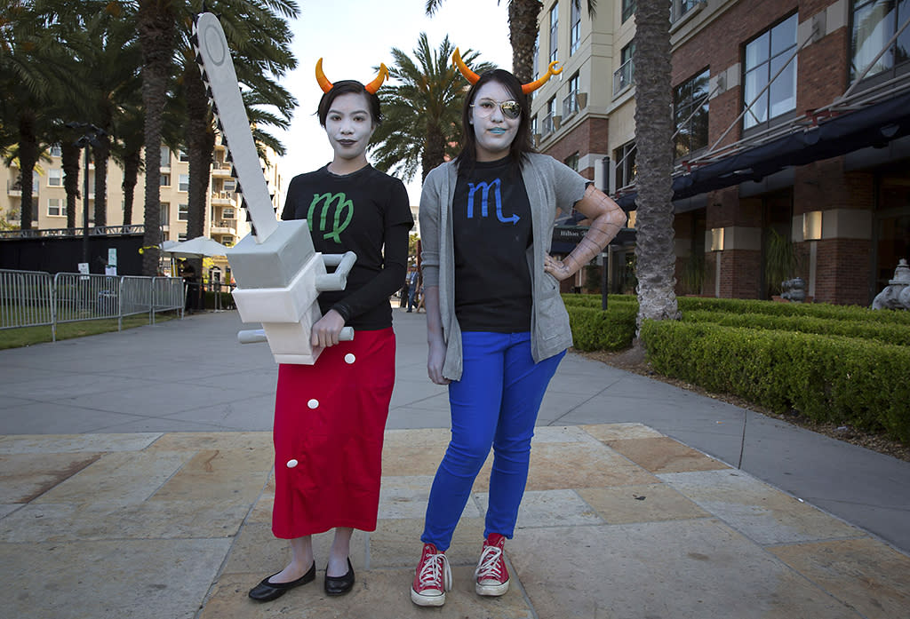 "Cosplayers Julia Gurrola (L) and Vriska Serket  pose while dressed as characters from webcomic ""Homestuck"" during the 2013 San Diego Comic-Con (SDCC) International in San Diego, California July 18, 2013. REUTERS/Fred Greaves (UNITED STATES - Tags: ENTERTAINMENT SOCIETY)"