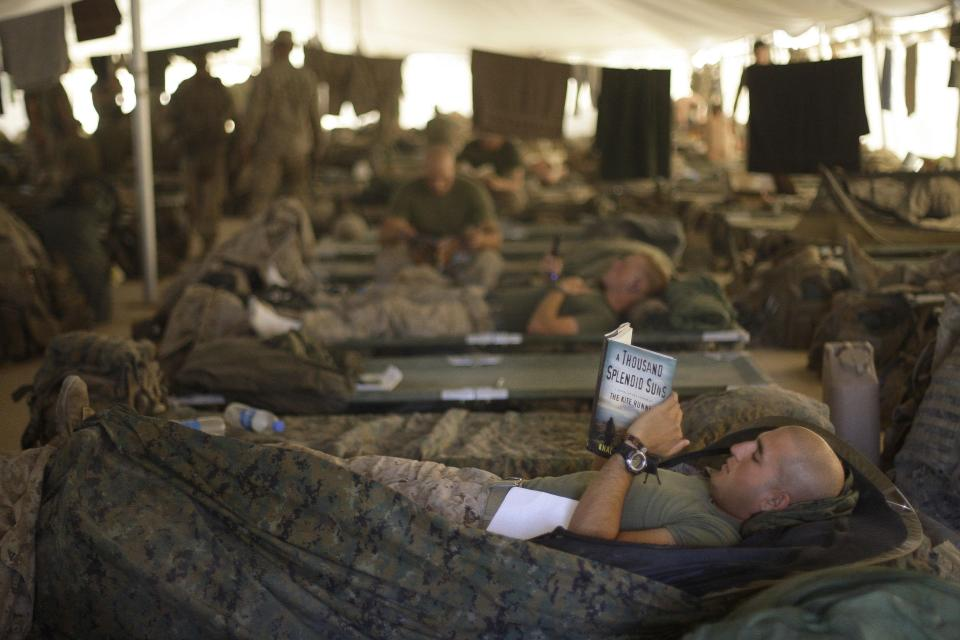 U.S. Marines from the 2nd Marine Expeditionary Brigade rest inside a tent at Camp Leatherneck in Afghanistan's Helmand province on June 9, 2009. (AP Photo/David Guttenfelder, File)