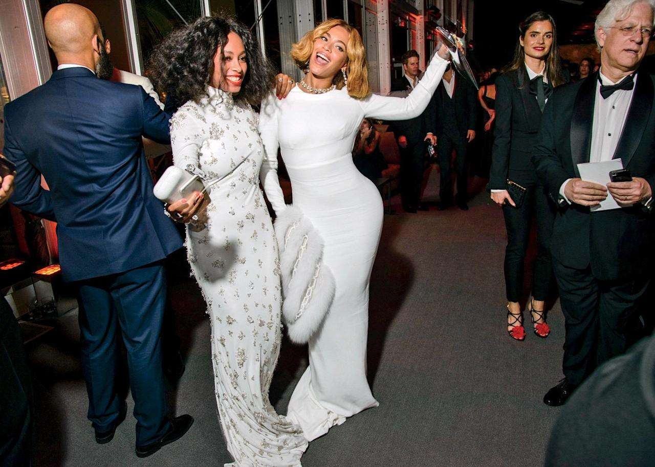 Solange Knowles and Beyoncé dancing the night away at the 2015 Oscar party.
